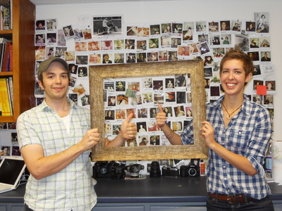 In-sight Photography, Brattleboro: Two people holding an empty frame making a thumbs up