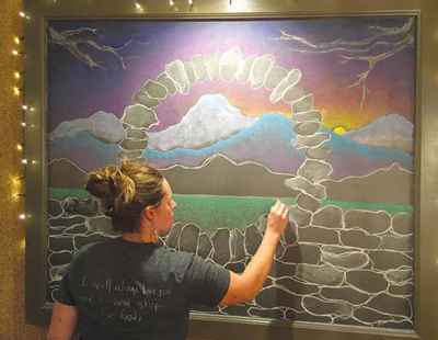 Rebecca works at Junction, a restaurant at the Essex Resort and Spa. She also creates the masterful chalk art on the walls at the resort.
