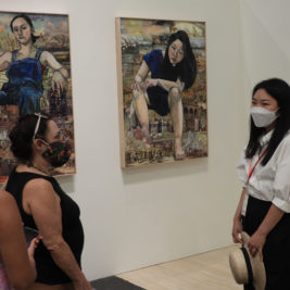 """Maintaining appropriate spatial distancing, artist Misoo Bang talks with visitors about her """"Giantess"""" painting series at the reception of the new """"Women Take Wilson"""" exhibit at Southern Vermont Art Center in Manchester. Photo: Catherine Crawley"""