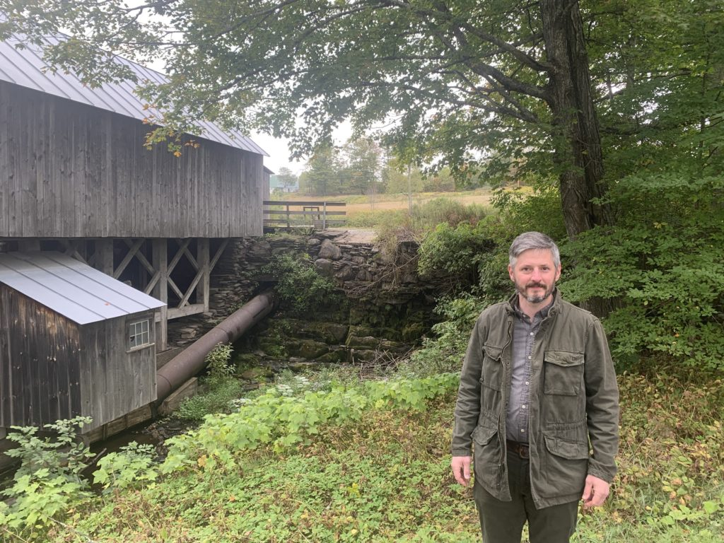 Otto Muller standing in front of the old sawmill at Kents Corner.