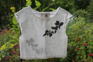 Front view of an Amsonia shirt with a print of a tree branch on the left shoulder
