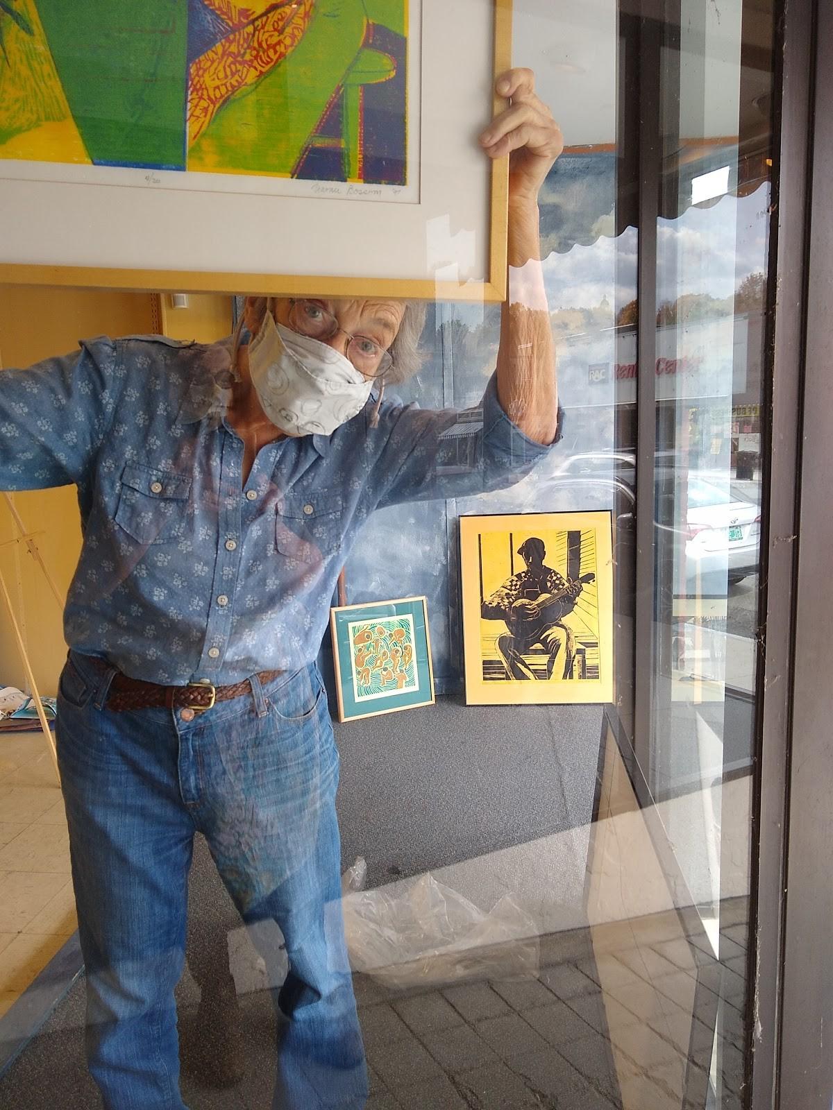 Artist Naomi Bossom hangs art in Saint Johnsbury