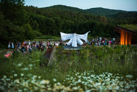 An outdoor performance at Vermont Performance Lab's 10th anniversary party