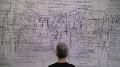 "A gallery visitor views Semuru Tekin's ""Tracking Time"""