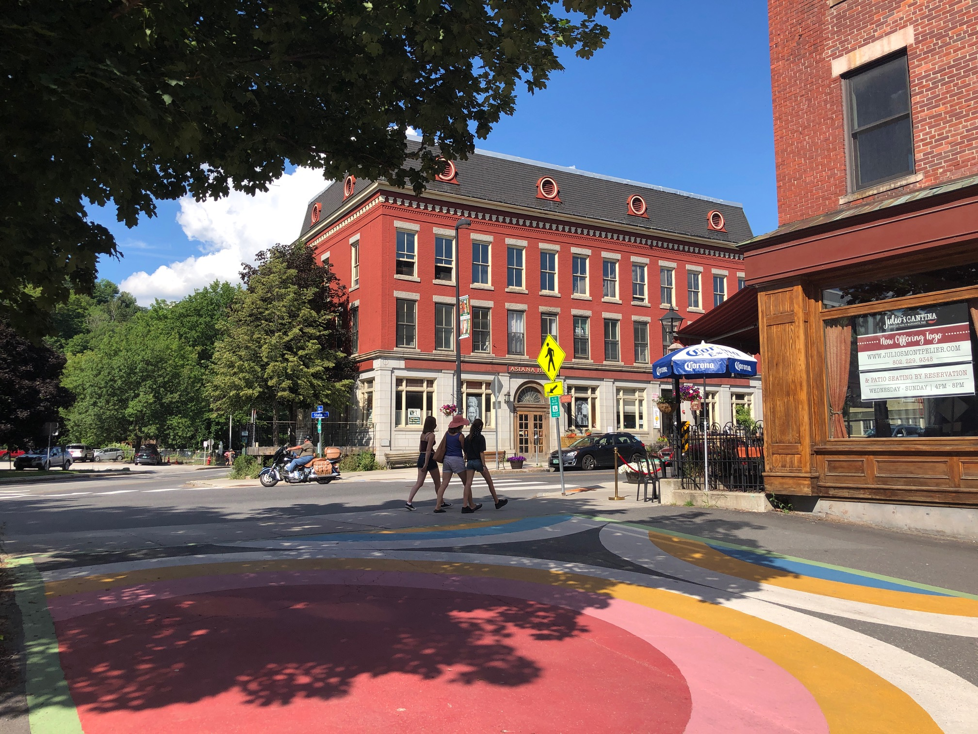 Colorful pavement art in Montpelier at the intersection of State Street and Elm.