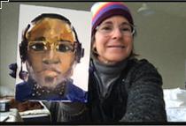 Rebecca Kincaid holding up her portrait of Jason Broughton