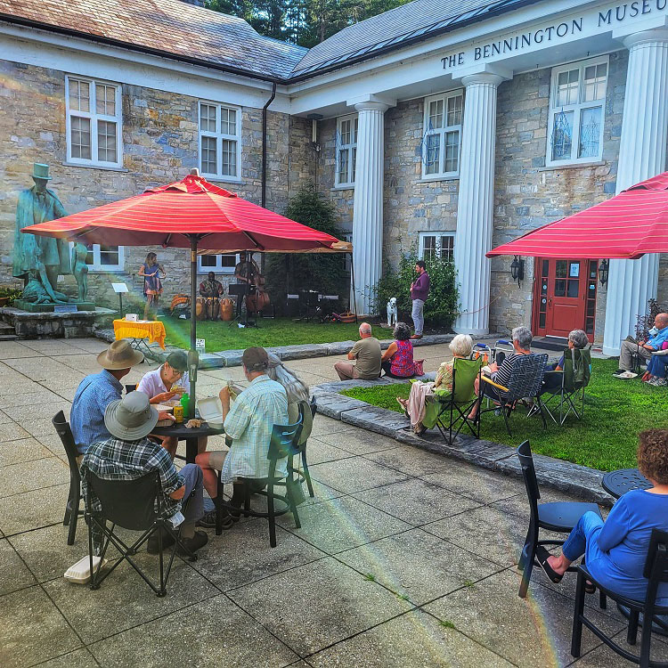 The audience and performers gathered in the Bennington Museum courtyard.